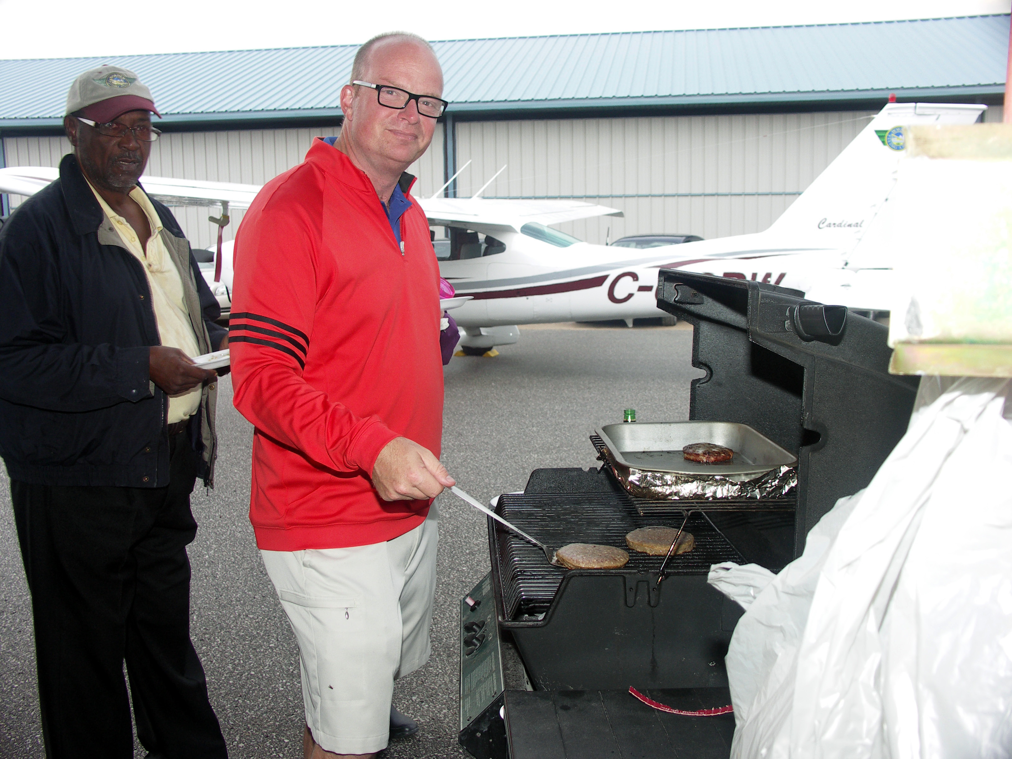 Grill Master Chris Thompson and one our guests Raule, taking care of business.