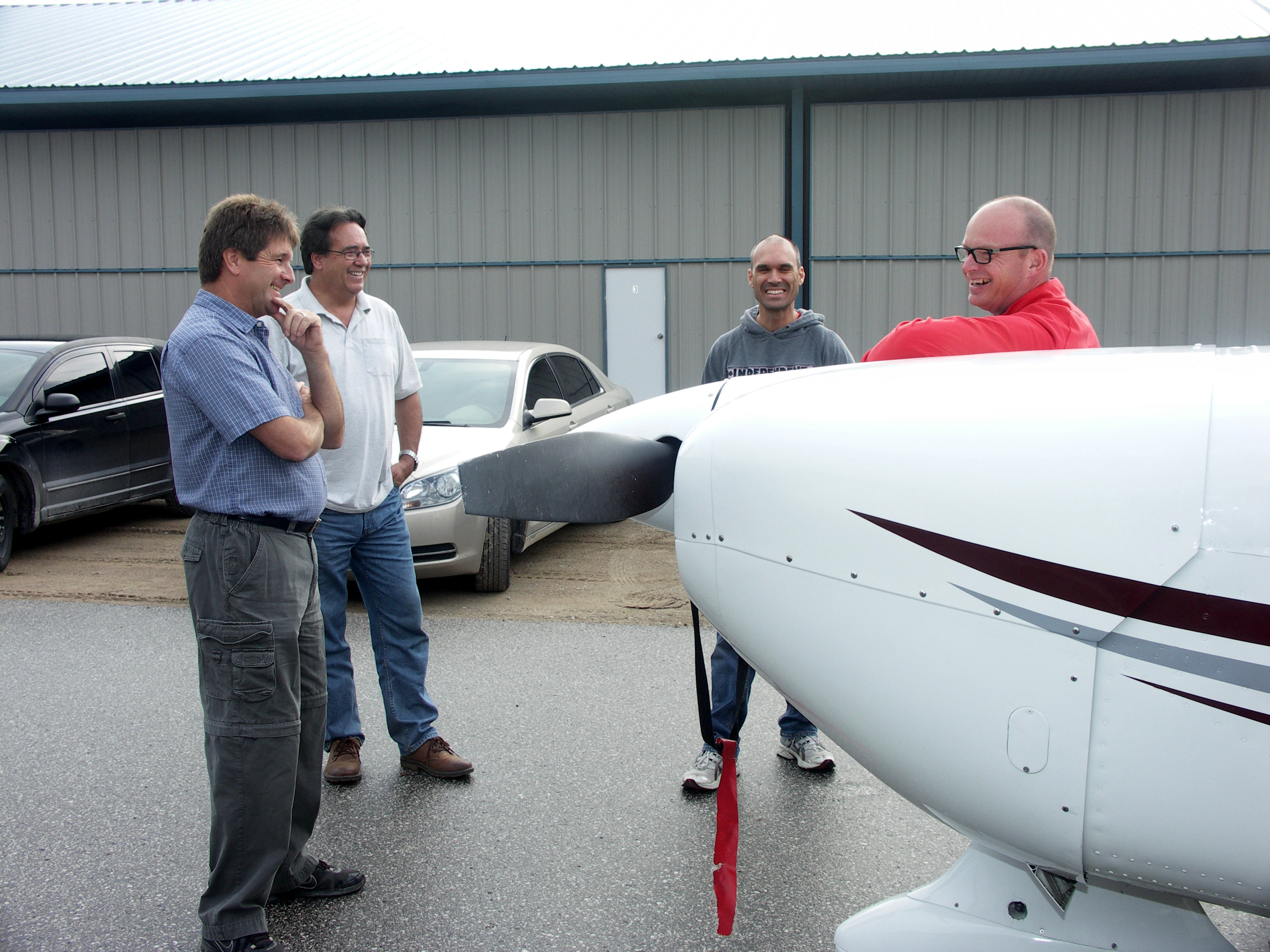 Several of our flying members. Discussing the finer points of flying the Cardinal. Owen, Paul, Chris and Steve M