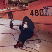 Carol Haire restoring a Fairchild 24R